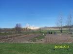Amish women and children in garden viewing Hi Crush Blasts